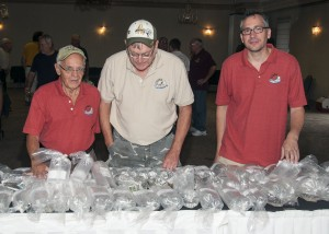 SNEKA Members look over the auction fish